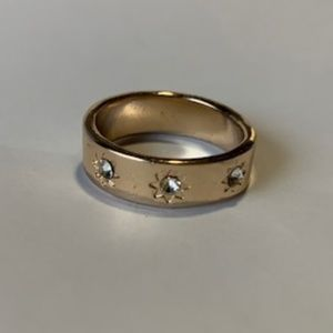 Gold band with gems